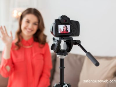 Woman uses DSLR camera to produce branded video content