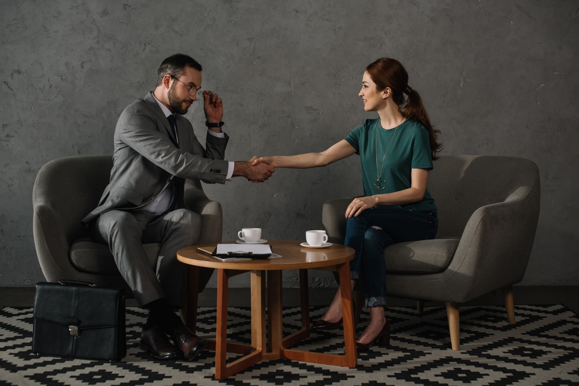 Attorney and client meet at small coffee table