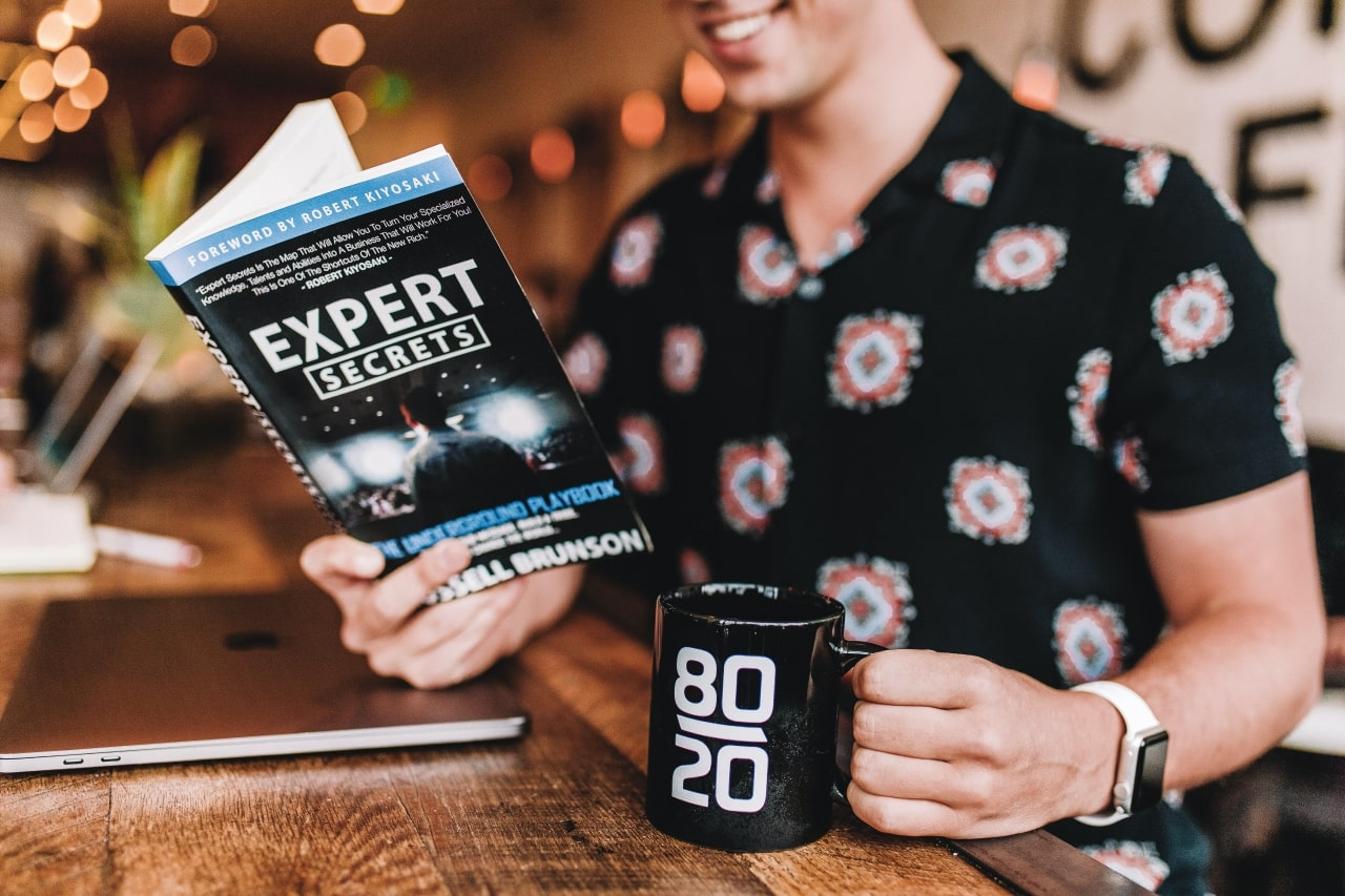 Man reading marketing book and 80/20 email marketing in Silicon Valley
