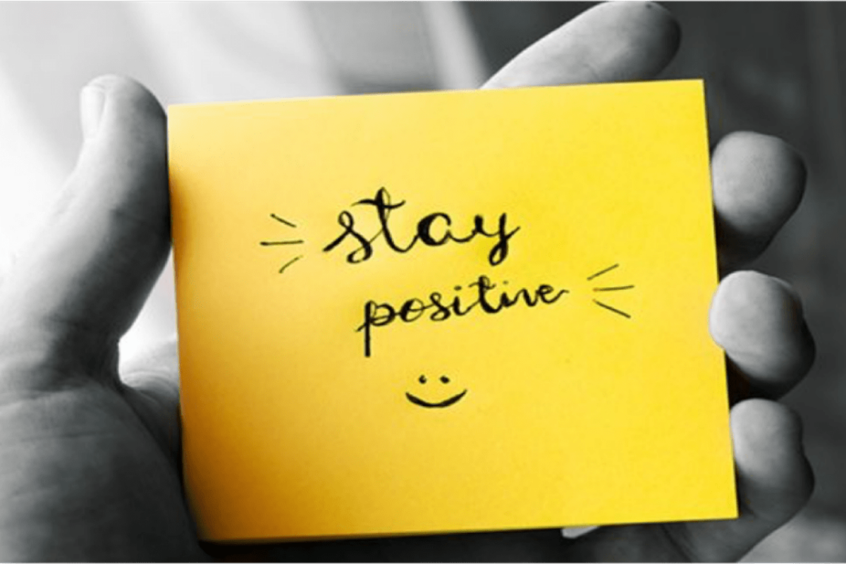 Yellow post-it note saying stay positive